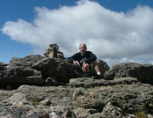 Scott Oatley on the summit of Hagues Peak in Rocky Mountain National Park